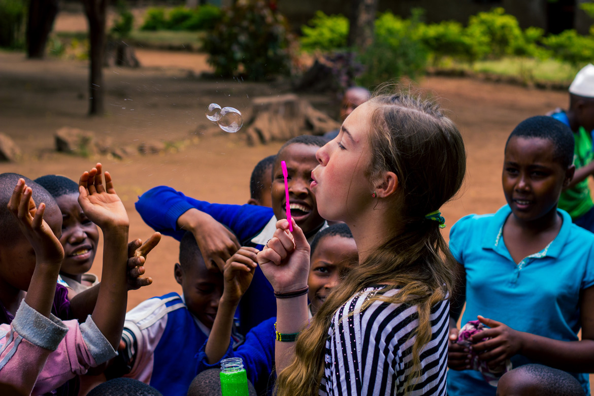 Abbie blowing bubbles to the delight of the school children