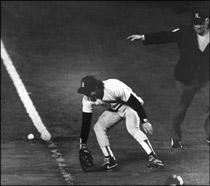 the ball rolls past Bill Buckner