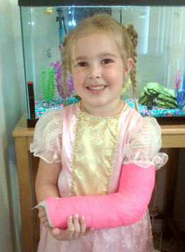 Abbie in a pink cast and a pink princess dress